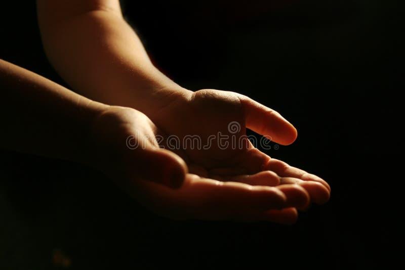 Mãos de adoração imagem de stock royalty free