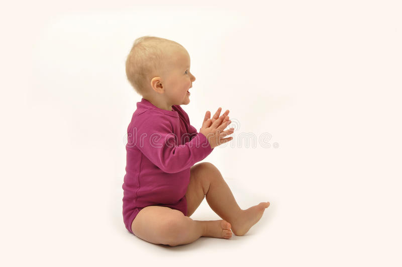 Mãos de aplauso do bebê imagem de stock