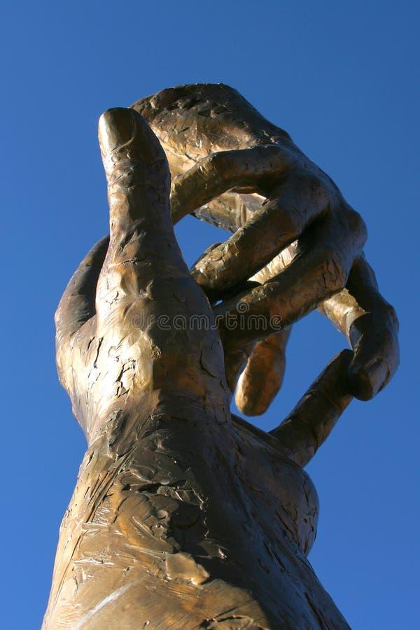 Mãos de bronze foto de stock royalty free