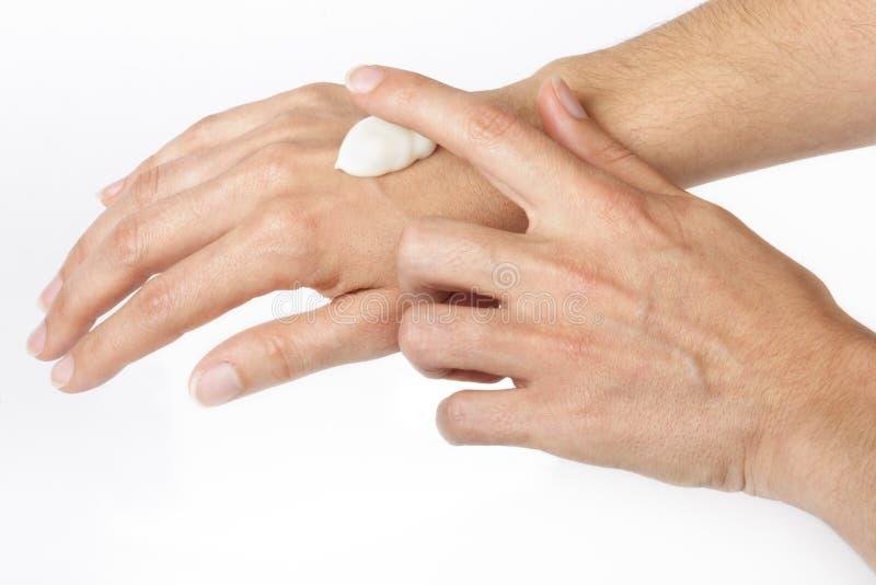 Mãos De Creme Fotografia de Stock Royalty Free