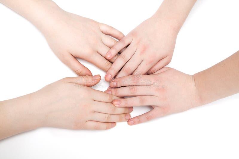 Mãos de duas raparigas imagens de stock royalty free