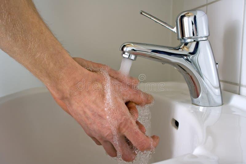 Mãos de lavagem imagens de stock royalty free