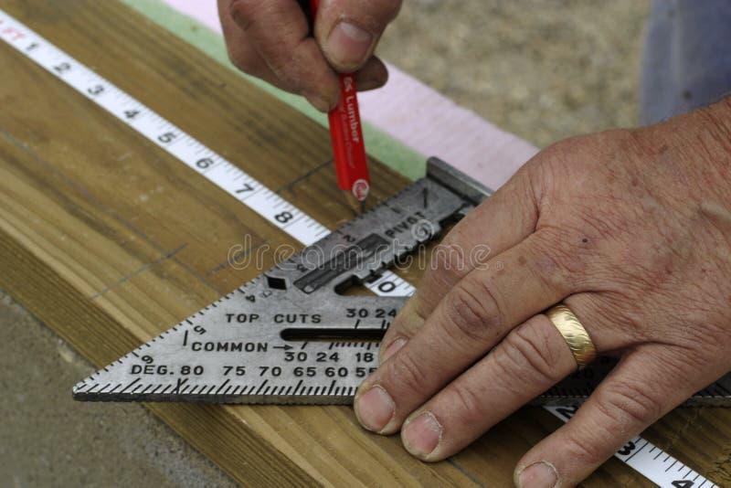 Mãos de medição foto de stock royalty free