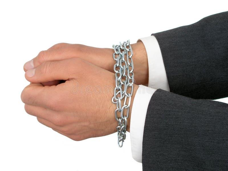 Mãos do homem de negócios nas correntes imagens de stock royalty free