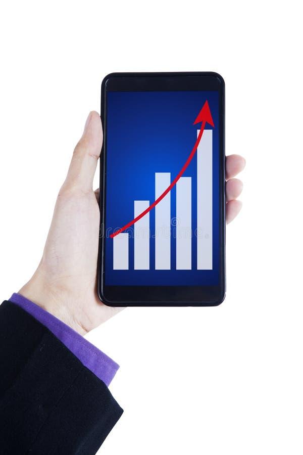 Mãos do homem de negócios que mostram o gráfico do crescimento imagens de stock royalty free