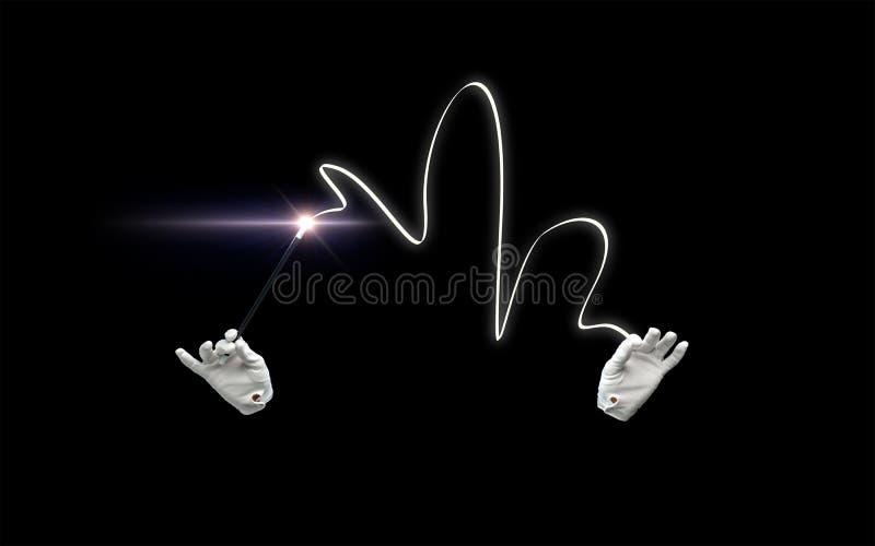 Mãos do mágico com truque mágico da exibição da varinha fotografia de stock royalty free