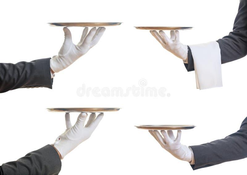 Mãos dos garçons que guardam bandejas imagens de stock
