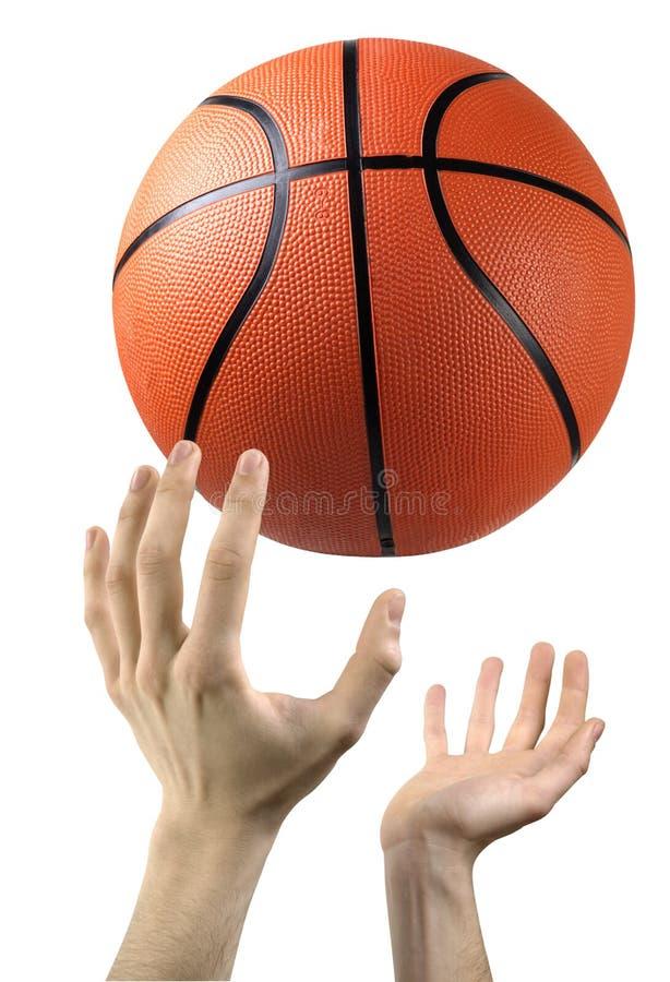 Mãos e basquetebol imagens de stock