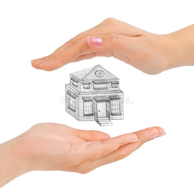 Mãos e casa colocadas imagem de stock