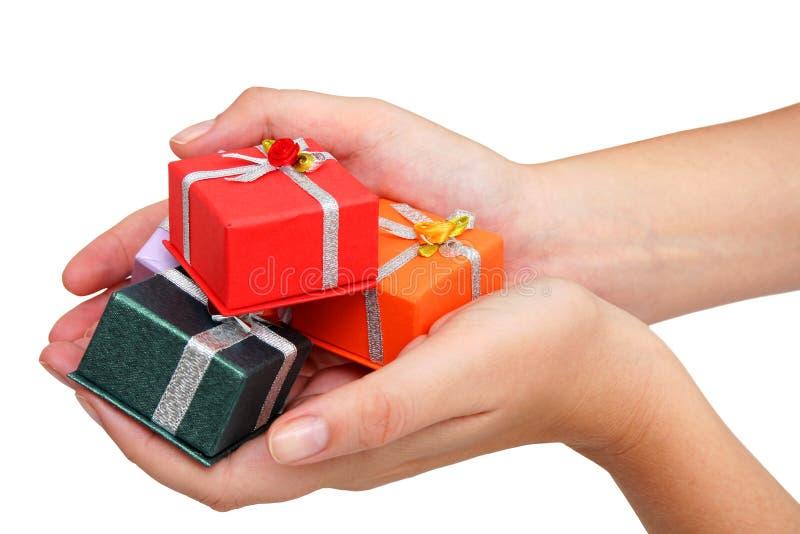 Mãos e presentes imagens de stock royalty free