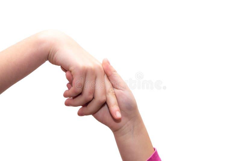 Mãos entrelaçadas das meninas, toque das mãos imagens de stock