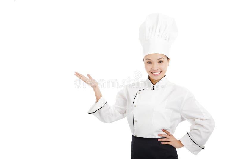 Mãos fêmeas profissionais do aumento do cozinheiro para mostrar algo foto de stock