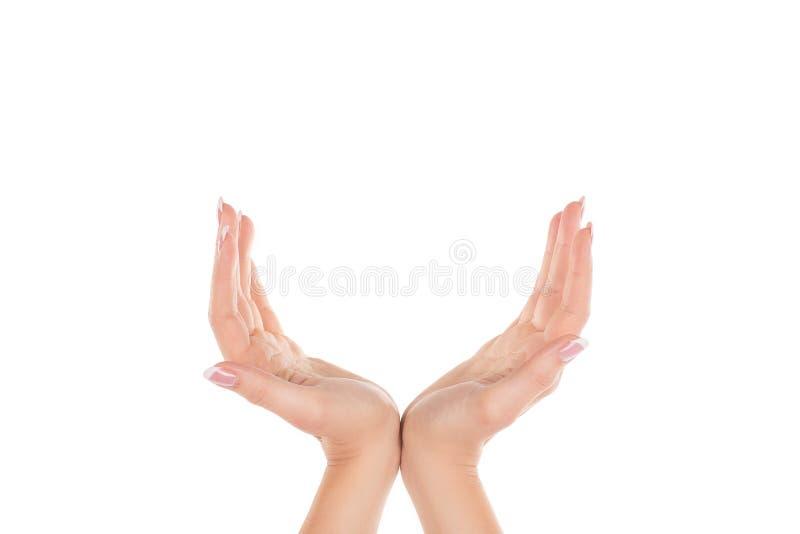 Mãos fêmeas que fazem o gesto, palmas abertas junto, isolado no branco fotos de stock