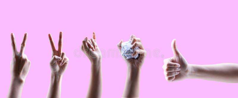Mãos fêmeas separadas de se no assoalho cor-de-rosa imagem de stock