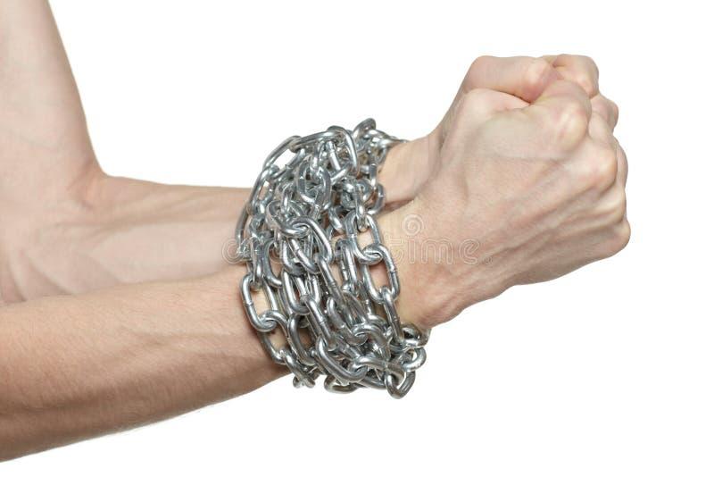 Mãos masculinas acorrentadas fotografia de stock royalty free