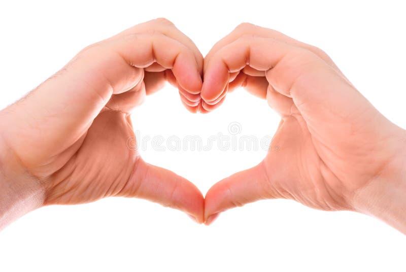 Mãos masculinas do coração fotografia de stock royalty free
