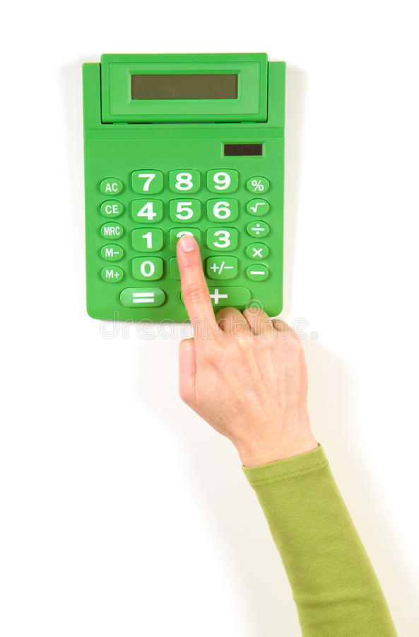Mãos no revestimento verde e na calculadora verde fotos de stock royalty free