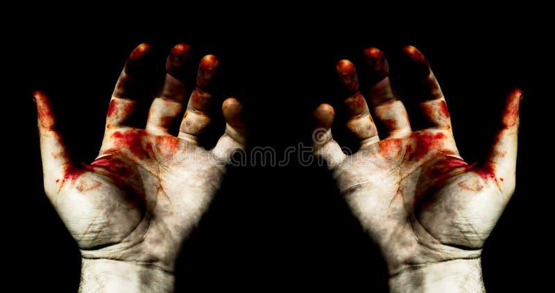 Mãos no sangue fotografia de stock