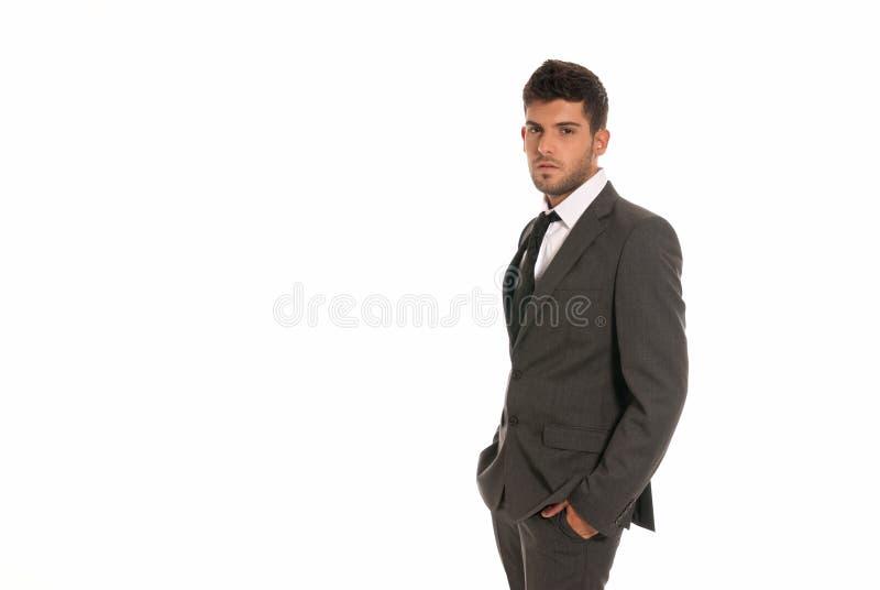 Mãos novas do olhar do cópia-espaço do homem de negócios no bolso imagem de stock