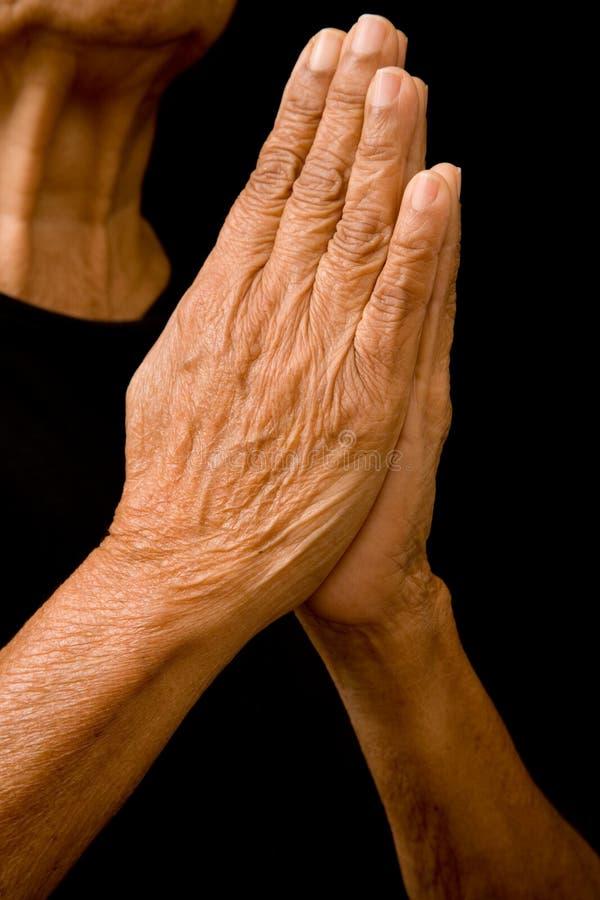 Mãos Praying imagem de stock