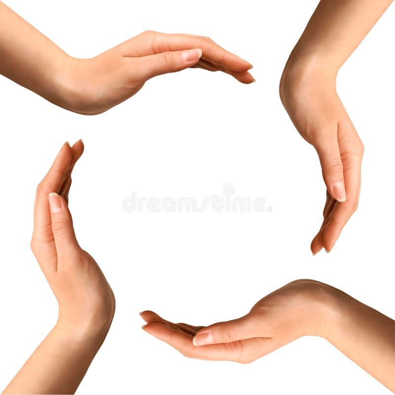 Mãos que fazem um círculo imagem de stock