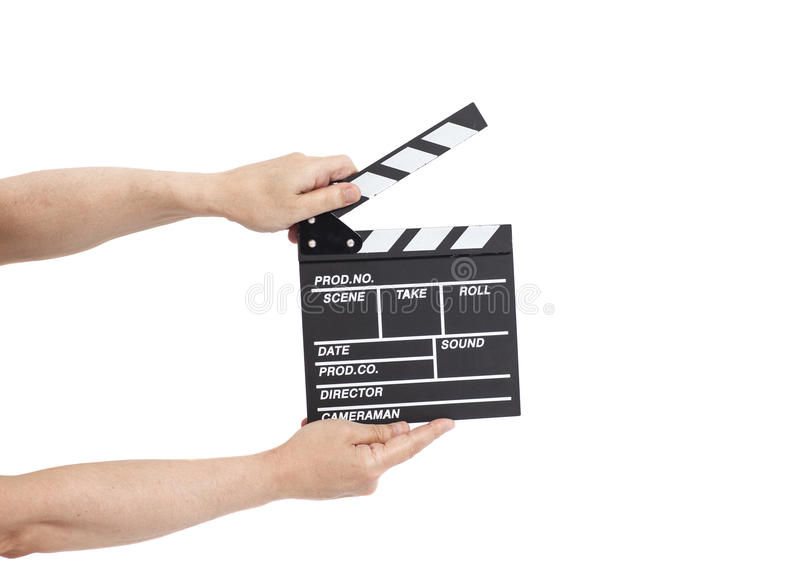 Mãos que guardam o clapperboard do filme fotos de stock royalty free