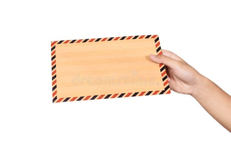 Mãos que guardam o envelope marrom fotografia de stock royalty free