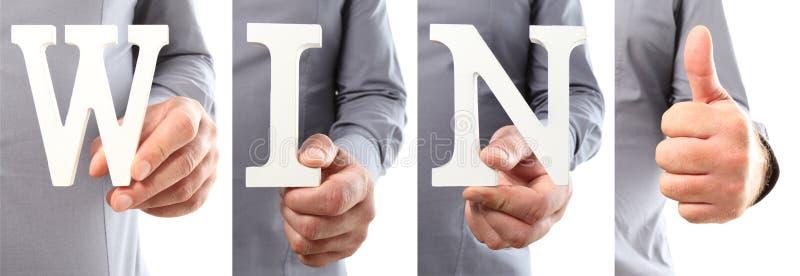 Mãos que guardam a palavra da vitória do texto da letra fotos de stock royalty free
