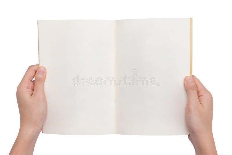 Mãos que guardam um livro vazio foto de stock royalty free