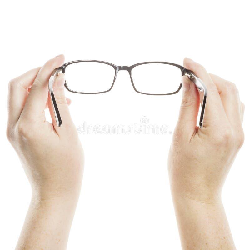 Mãos que guardaram vidros imagem de stock
