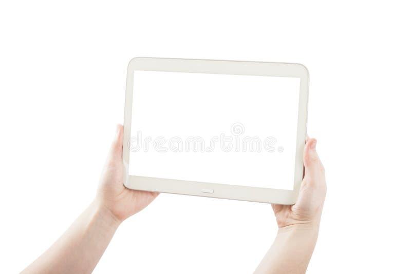 Mãos que mantêm a tabuleta do PC isolada foto de stock royalty free