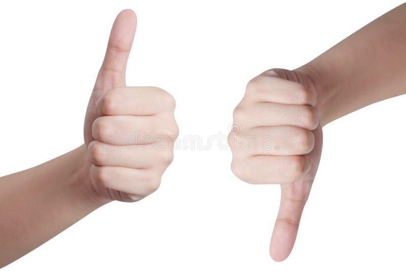 Mãos que mostram os polegares acima e para baixo imagens de stock royalty free