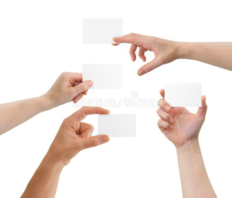 Mãos que prendem cartões em branco com cópia-espaço fotos de stock