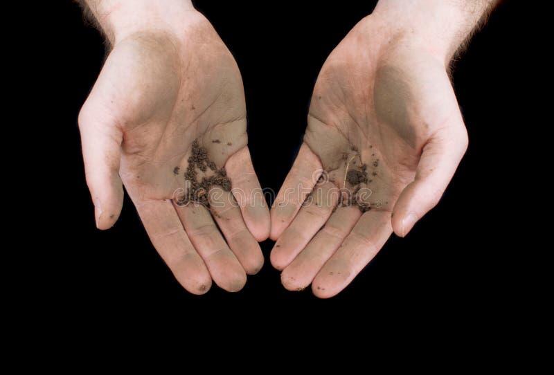 Mãos sujas isoladas no preto imagens de stock royalty free