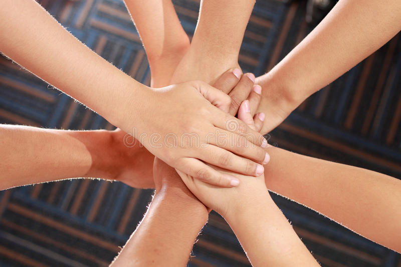 Mãos unidas foto de stock
