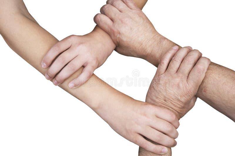 Mãos unidas isoladas com trajeto de grampeamento fotos de stock