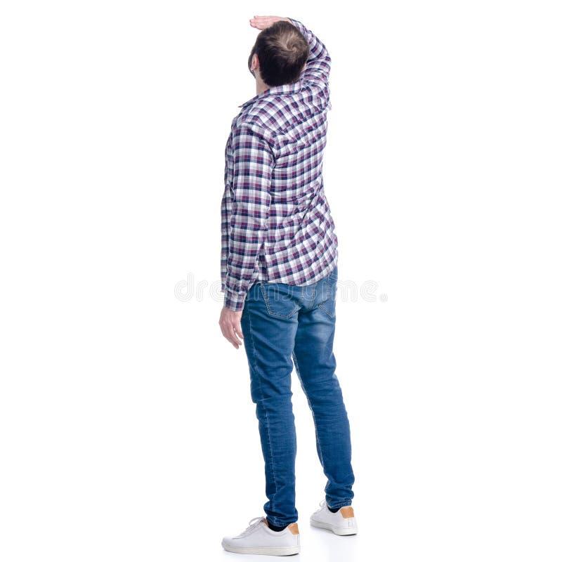 Mężczyzna w cajgach i koszula spojrzenia w odległość zdjęcia royalty free