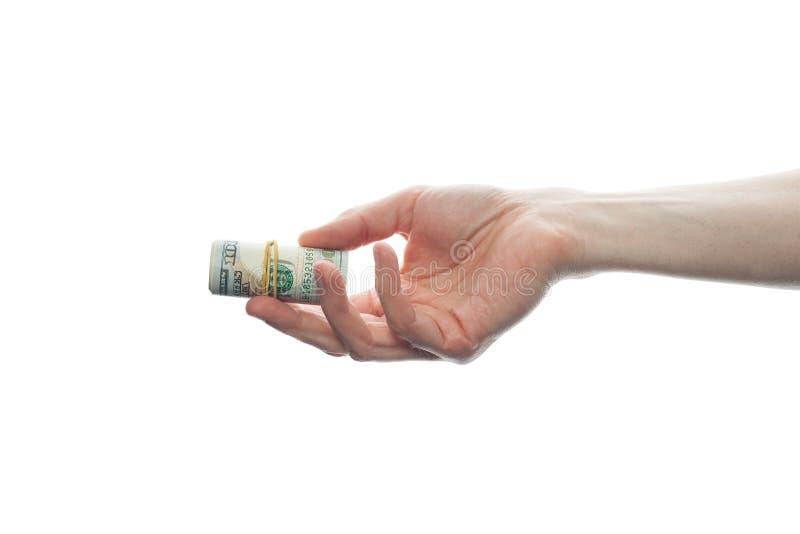 Męska ręka daje my dolarom spienięża pieniądze rolkę odizolowywającą na białym tle Nowożytny Amerykański dolara 100 banknot zdjęcie royalty free