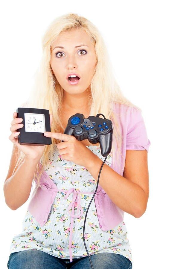 Mädchen mit einem Steuerknüppel und einer Uhr stockfotos