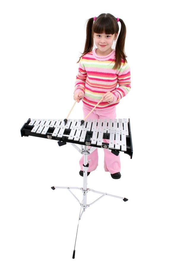Mädchen (7 Jahre) die Bell spielend stockbilder
