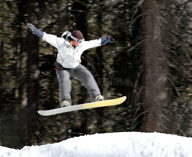 Mädchen auf einem Snowboard stockfoto