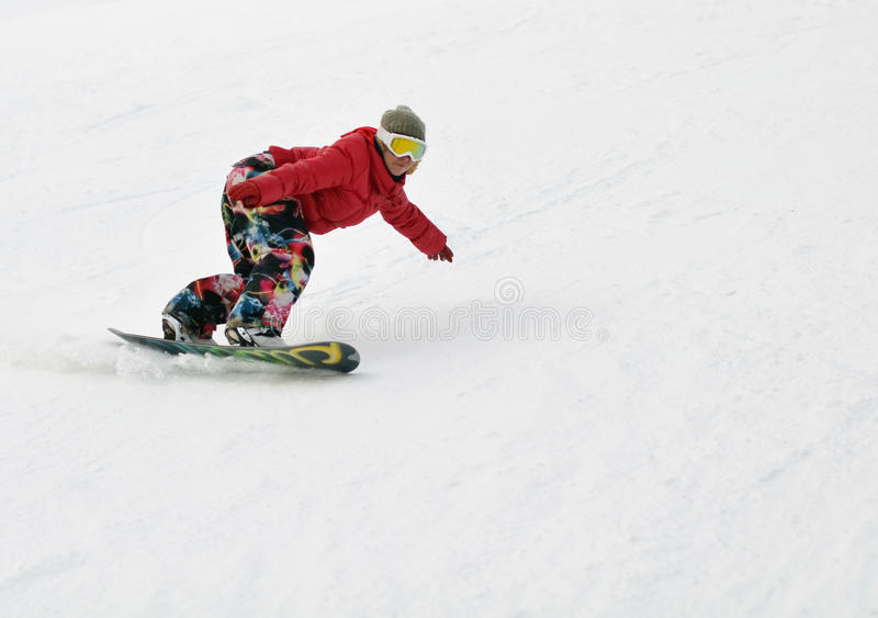 Mädchen auf Snowboard stockfotografie