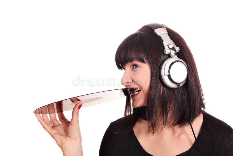 Mädchen beißt Langspielplatte-Satz stockfoto
