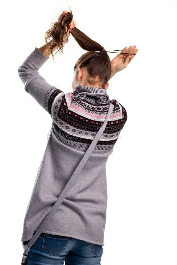 Mädchen berührt ihr Haar lizenzfreies stockbild