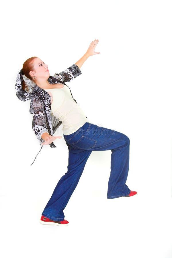 Mädchen, das über Weiß balanciert stockfotografie