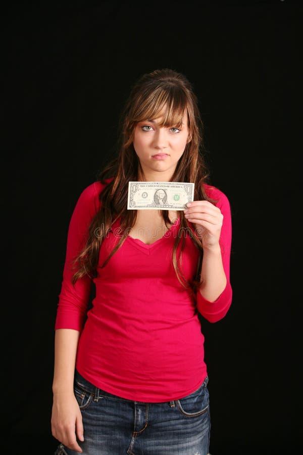 Mädchen, das alten Dollarschein anhält stockfotografie