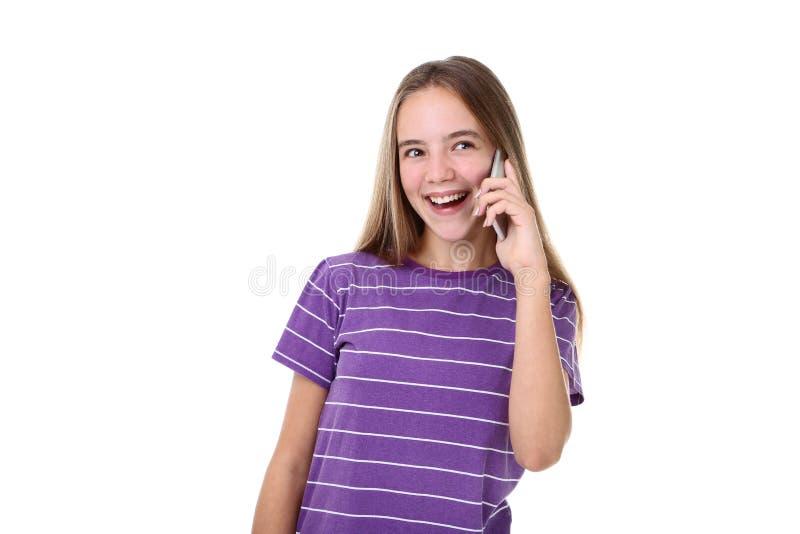 Mädchen, das auf einem Handy spricht lizenzfreie stockbilder