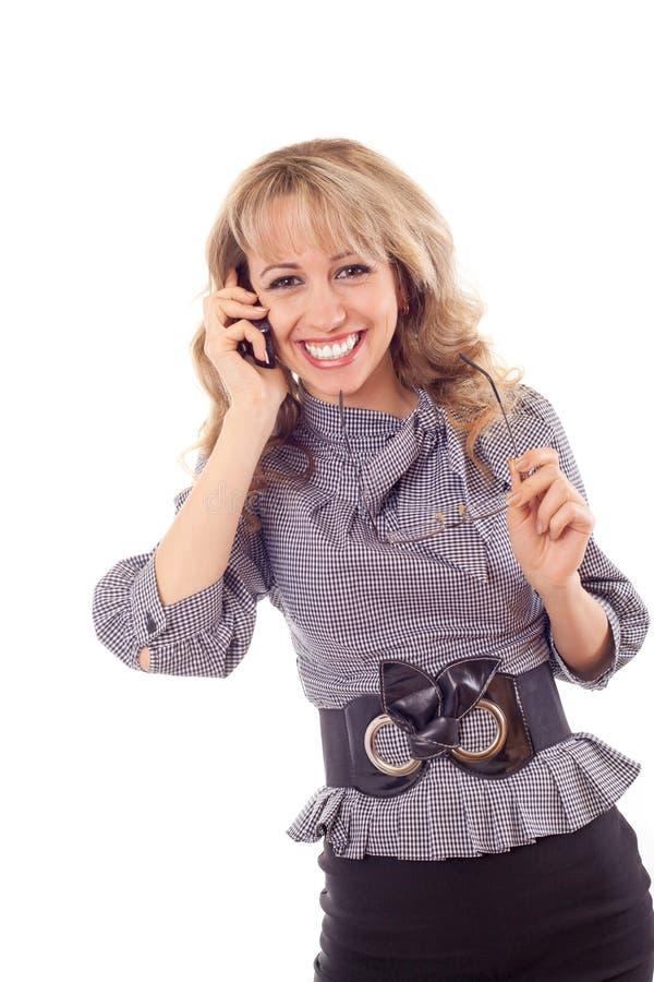 Mädchen, das auf Handy spricht lizenzfreie stockfotografie