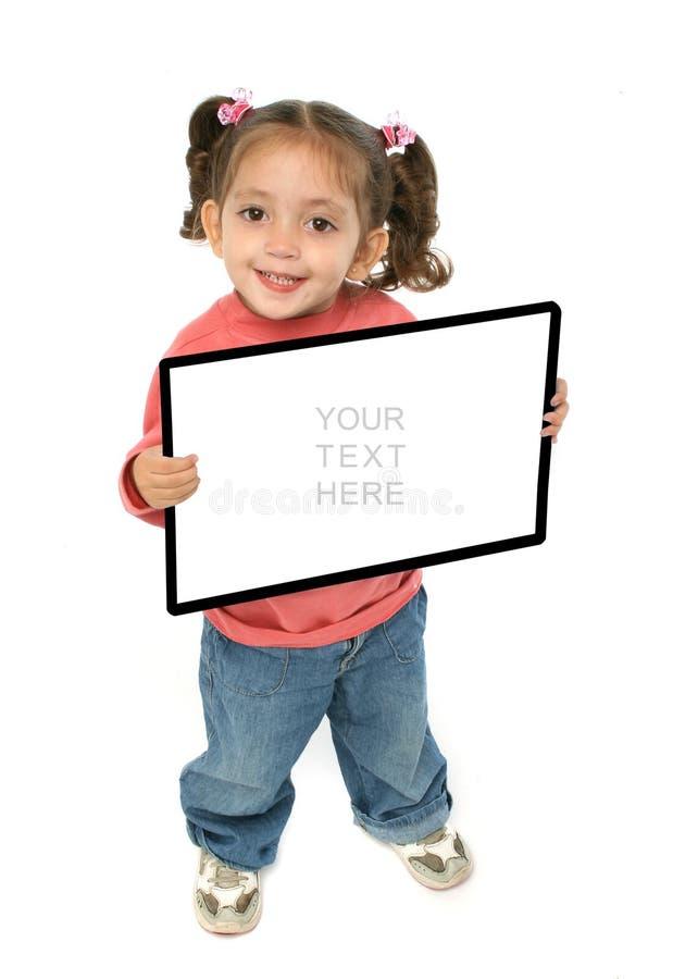 Mädchen, das ein unbelegtes Zeichen anhält stockfotos