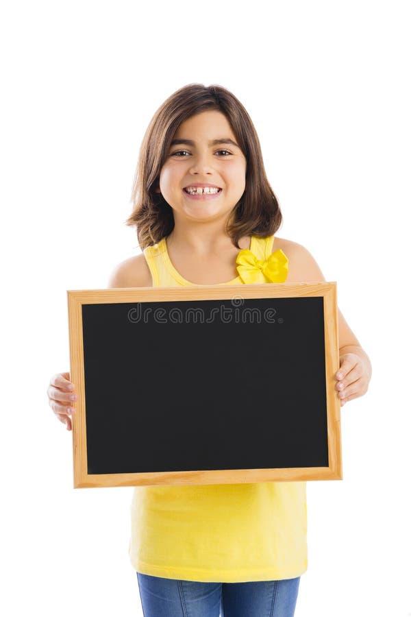 Mädchen, das eine Tafel hält stockbild